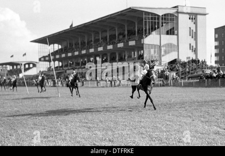 Hamburg, Germany, horses and jockeys in front of the grandstand the racecourse - Stock Photo