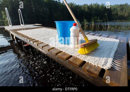 Carpet washing equipment at jetty , Finland - Stock Photo