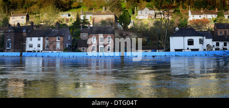 Environment Agency flood barriers protect properties from the River Severn on the Wharfage in Ironbridge. - Stock Photo