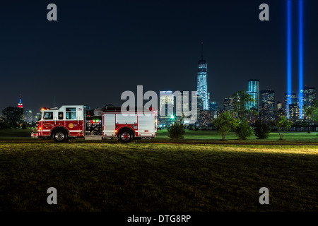 Hillcrest Fire Company Number 1 firetruck with a background view of the New York City Skyline  with the Empire State - Stock Photo