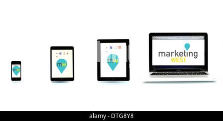 Iphone, ipad mini, ipad and macbook arranged small to large on white background - Stock Photo
