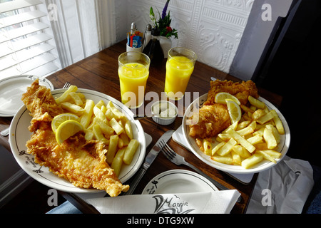 Fish and chips for two at a window table at the famous Magpie Café in historic  Whitby North Yorkshire England UK - Stock Photo