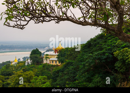 MANDALAY, MYANMAR - CIRCA DECEMBER 2013: View from one of the terraces in the SoneOoPoneNyaShin Pagoda in Sagaing - Stock Photo