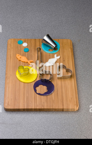 Cutting vegetables with biscuit cutters - Stock Photo