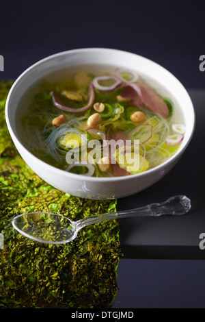 Brussels sprout broth with smoked duck magrets - Stock Photo