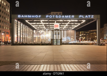 Potsdamer platz Bahnhof mainline station entrance on concourse to trains with rejuvenated city and modern skyline - Stock Photo