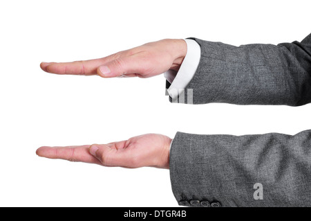 man wearing a suit with his hands open in parallel as showing or holding something, on a white background - Stock Photo
