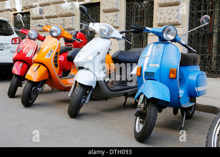 Vespas parked in a row in a back road, Vienna, Austria - Stock Photo