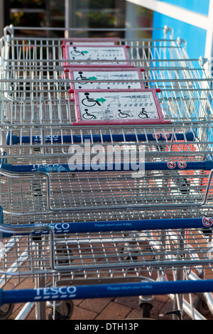 Supermarket parked shopping trolley for disabled customers Salisbury England UK - Stock Photo