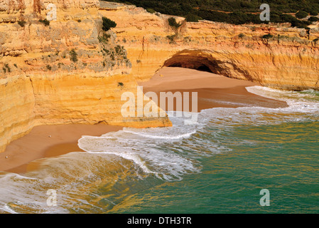 Portugal, Algarve: View to no name beach and small cave at the coast of Benagil - Stock Photo