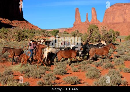 Navajo Cowboy herding Mustangs, native american, Monument Valley, Utah, USA - Stock Photo