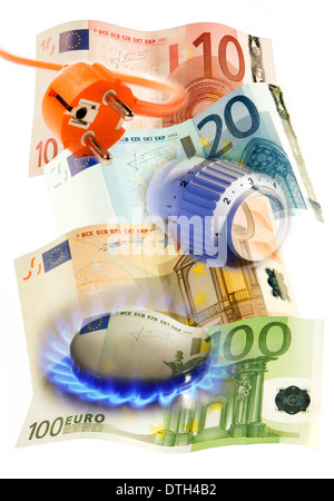 Plug, thermostat and detail of a gas cooker with euro bills. - Stock Photo