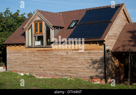 Solar thermal evacuated tubes on roof of barn Mickleton UK - Stock Photo