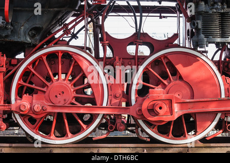 Red train wheels from old steam train - Stock Photo