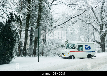 Mail delivery truck during a winter snow storm. - Stock Photo