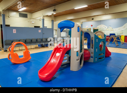 Slide and playground equipment indoors at a daycare centre - Stock Photo