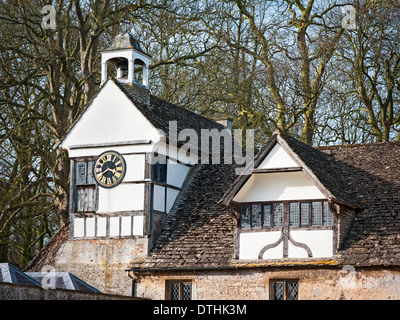Clock tower and courtyard buildings at Lacock Abbey UK - Stock Photo