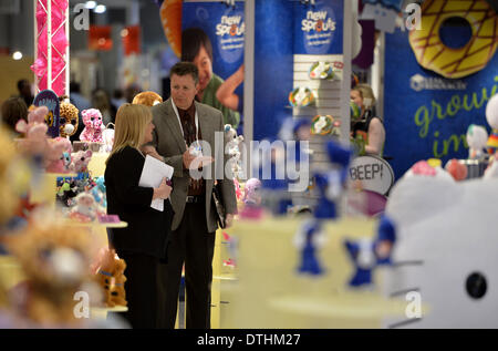 New York, NY, USA. 18th Feb, 2014. Exhibitors chat during the 111th American International Toy Fair in New York - Stock Photo