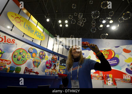 New York, NY, USA. 18th Feb, 2014. Chelsea Gonzalez, exhibitor from a Massachusetts toys company, showcases a new - Stock Photo