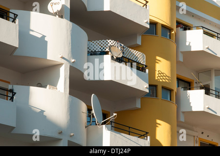 modern apartment building in the Algarve Portugal with satellite dishes - Stock Photo