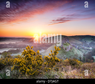 A frosty April sunrise overlooking the ruins of Corfe Castle on the Isle of Purbeck in Dorset - Stock Photo