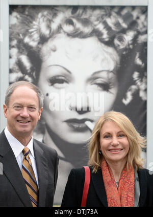 US ambassador John Bonell Emerson in Germany and his wife Kimberly Marteau Emerson stand in front of a placat of - Stock Photo
