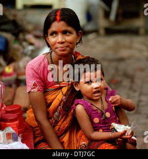 Tikka seller and daughter at Kalighat Hindu Temple in Kolkata Calcutta in West Bengal in India in South Asia. Real - Stock Photo
