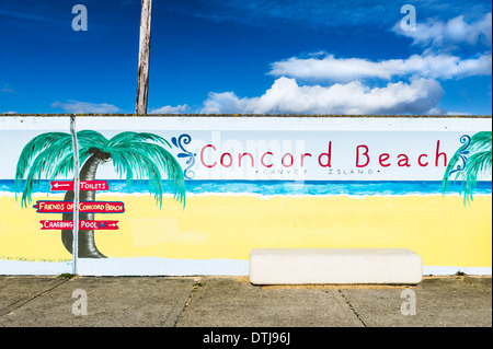 Canvey Island - A colourful mural painted on the sea wall flood defence at Concord Beach on Canvey Island in Essex. - Stock Photo