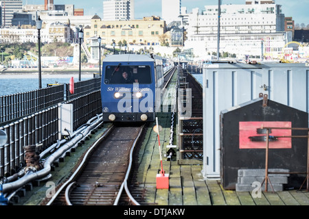 One of the pier electric trains travelling along Southend Pier. - Stock Photo