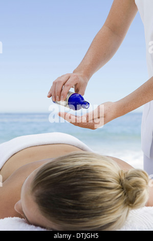 The beach A young woman having a massage Cape Town South Africa - Stock Photo