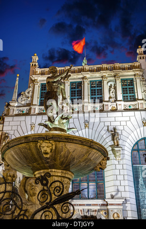 Neptune's fountain and Artus Court at night in Gdansk, Poland. - Stock Photo