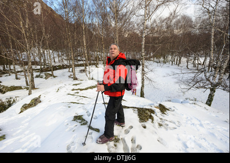 Middle aged man hiking in the Winter - Stock Photo