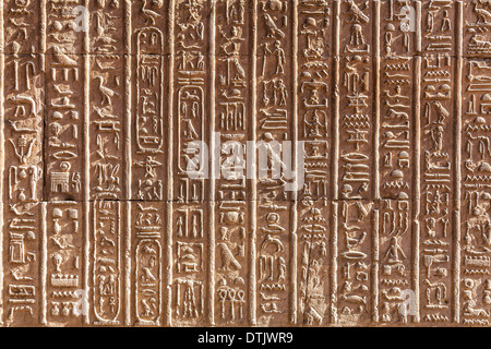 Bas relief hieroglyphic carvings on a wall of the Ancient Egyptian Temple at Kom Ombo. - Stock Photo