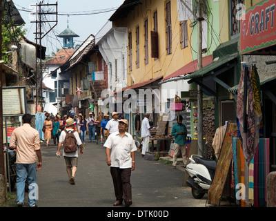 India, Kerala, Fort Cochin, Mattancherry, Jewtown, visitors in Synagogue Lane - Stock Photo