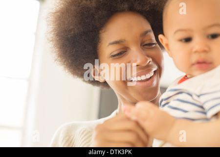 Mother holding baby boy - Stock Photo