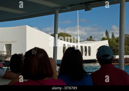 Tourist arriving by boat to the USS Arizona Memorial, Pearl Harbor, Oahu, Hawaii - Stock Photo
