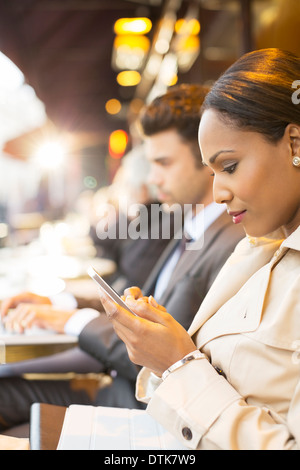 Business people working at sidewalk cafe - Stock Photo