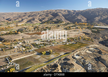 Domain Road Vineyard, and Carrick Range, Bannockburn, Central Otago, South Island, New Zealand - aerial - Stock Photo