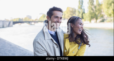 Couple walking along Seine River, Paris, France - Stock Photo