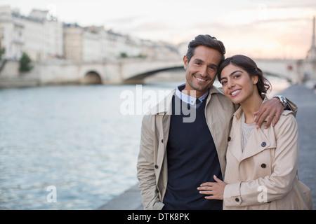 Couple walking along Seine River, Paris, France - Stock Photo