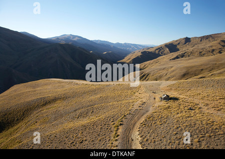 Old Hut Above Cardrona Valley, Otago, South Island, New Zealand - aerial - Stock Photo