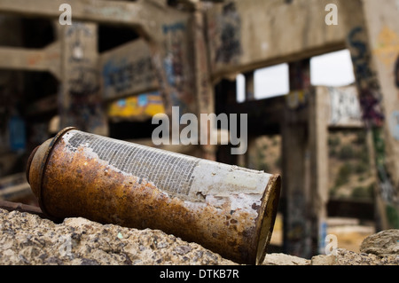 Old cans of spray paint at an abandoned mine - Stock Photo