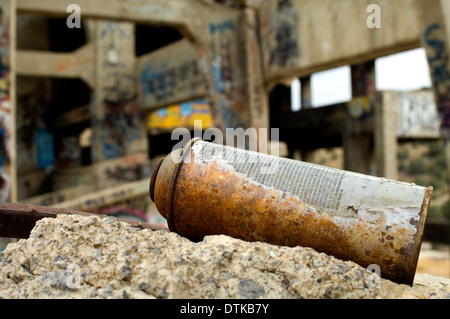 Old can of spray paint at an abandoned mine - Stock Photo