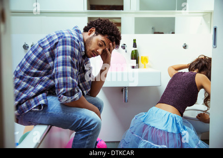 Drunk couple in bathroom at party - Stock Photo