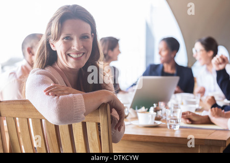 Businesswoman smiling in meeting - Stock Photo
