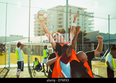 Soccer players cheering on field - Stock Photo