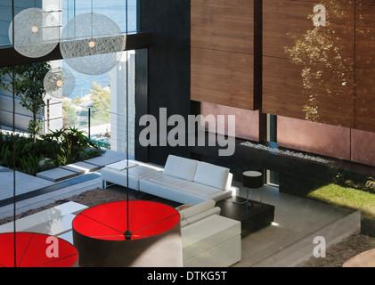 Modern living room in open floor plan - Stock Photo