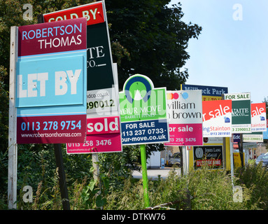 numerous for sale and to let signs outside homes united kingdom - Stock Photo