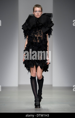 A model wears a design created by John Rocha during London Fashion Week Autumn/Winter 2014, at Somerset House. - Stock Photo