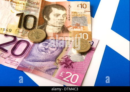 Scotland Independence generic image of scottish money on a small Cross of St Andrew - Stock Photo